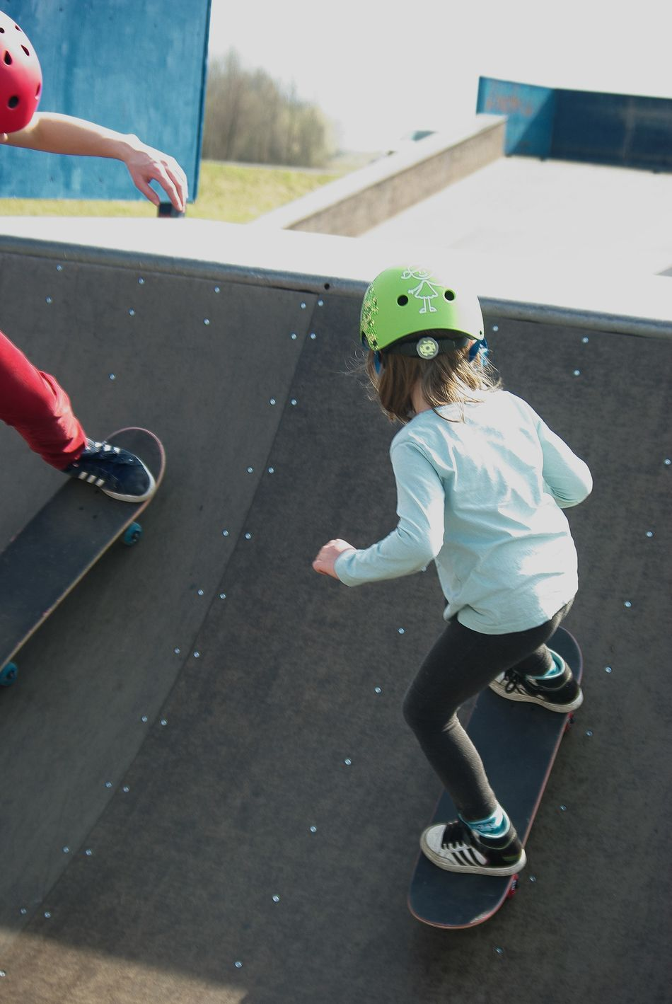 Action Shot  Child Childhood Friendship Girl Power Headwear Kids Sports Leisure Activity Miniramp Outdoors Real People Skateboard Park Skateboarding Skatepark Skateparks  Sport Two People Double Trouble