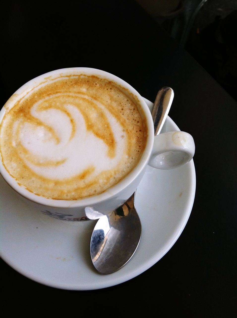 coffee cup, coffee - drink, frothy drink, drink, refreshment, saucer, cappuccino, food and drink, cup, table, froth art, no people, high angle view, close-up, indoors, freshness, latte, day