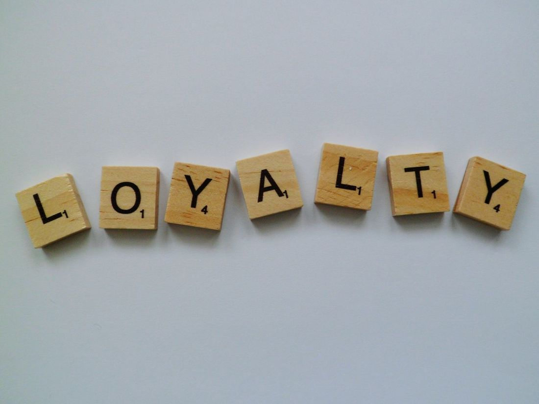 Loyalty Wood - Material Simplicity Still Life Leisure Games Creativity The Alphabet Leisure Activity Text Indoors  Words Phrase Plain Background White Background Word Game Communication Studio Shot Western Script Close-up Capital Letter Low Angle View Word Letters Lettering Quote Loyalty