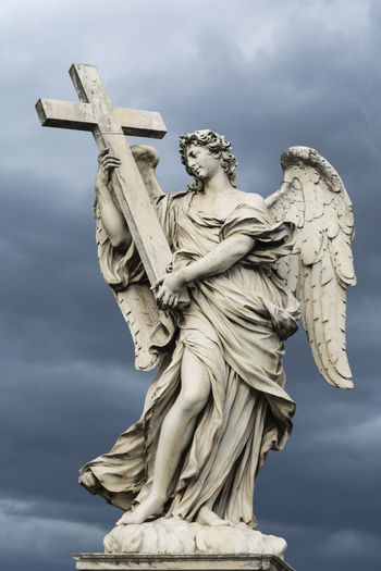 Angel with the Cross, one of the ten statues at bridge of angels in Rome, against stormy sky Catholic Christianity Cross Dramatic Sky Renaissance Rome Spirituality Statue Storm Vatican Angel Angelic Bridge Of Angels Catholicism Cloud - Sky Historic Holy Landmark Marble Ponte Sant'Angelo Religion Religious  Salvation  Sculpture Travel Destinations