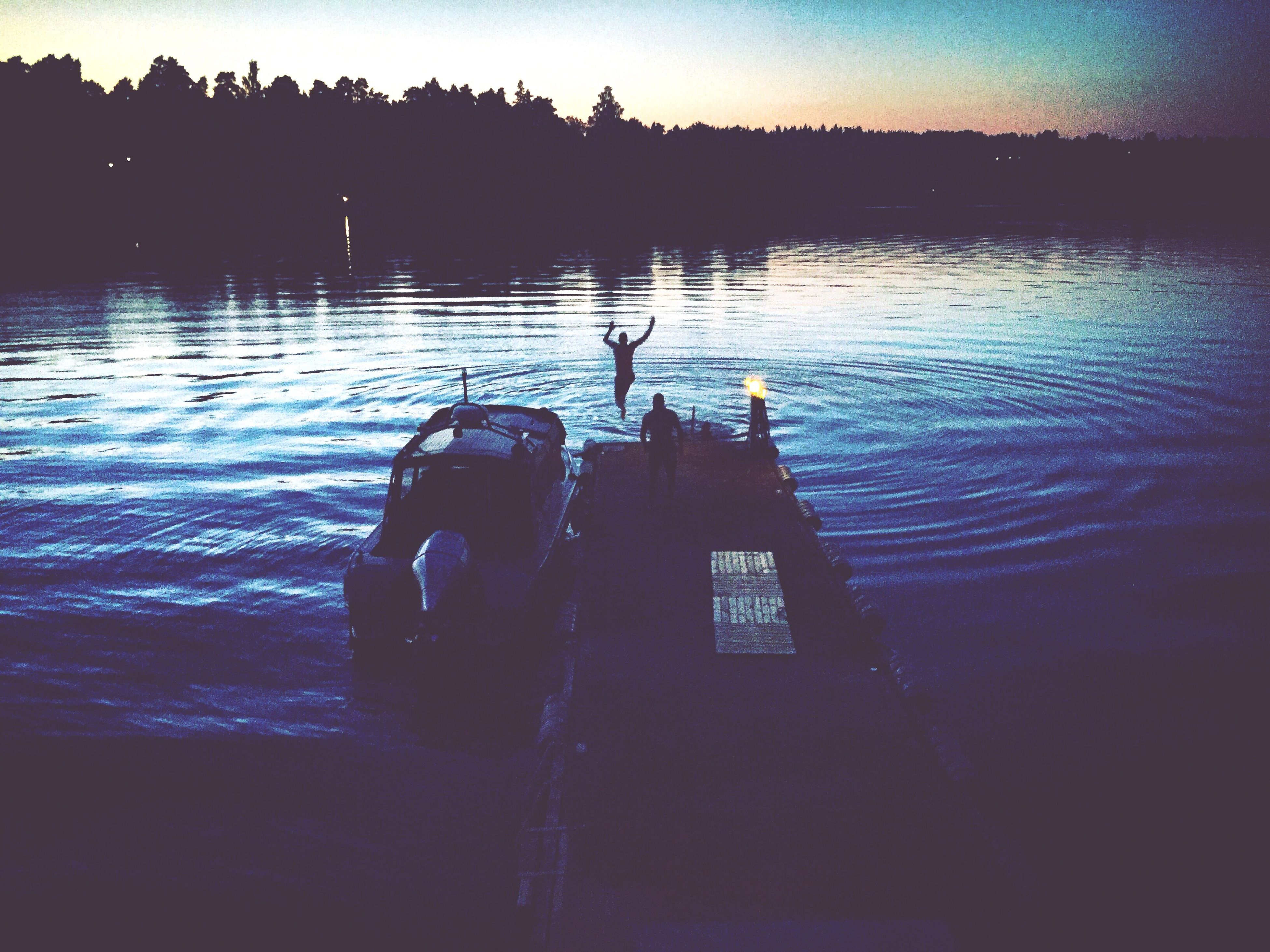 water, silhouette, reflection, lake, sea, tranquility, sky, nautical vessel, nature, sunset, tranquil scene, rippled, scenics, beauty in nature, boat, men, dusk, waterfront, outdoors, river