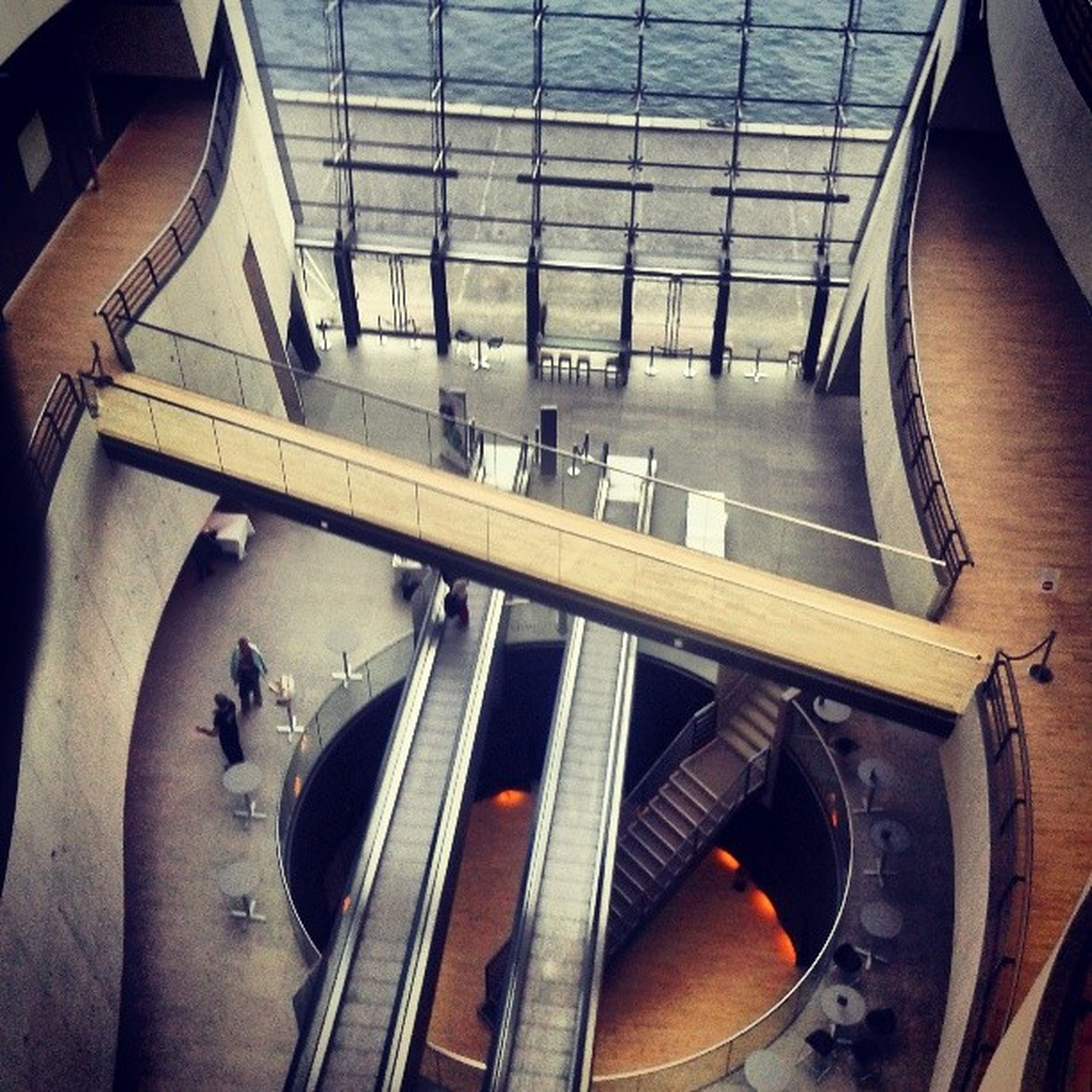 high angle view, transportation, men, lifestyles, indoors, part of, steps, railing, leisure activity, escalator, person, cropped, mode of transport, unrecognizable person, steps and staircases, staircase, low section