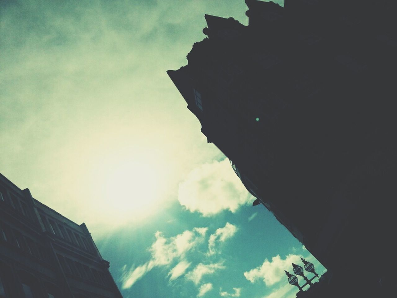 low angle view, sky, architecture, built structure, building exterior, cloud - sky, outdoors, day, no people, city