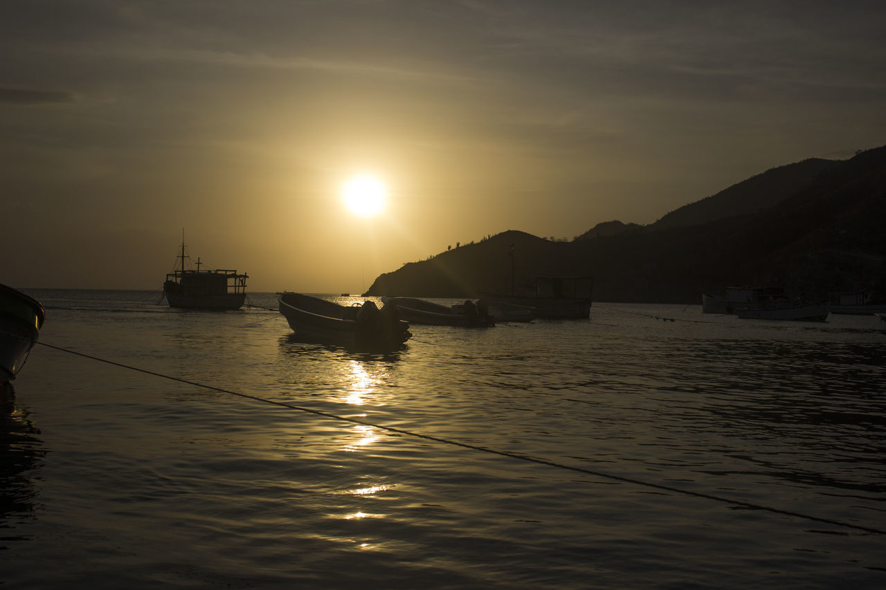 Beauty In Nature Boat Day Mode Of Transport Moored Mountain Nature Nautical Vessel No People Outdoors Reflection Scenics Sea Silhouette Sky Sun Sunlight Sunset Tranquil Scene Tranquility Transportation Water Waterfront