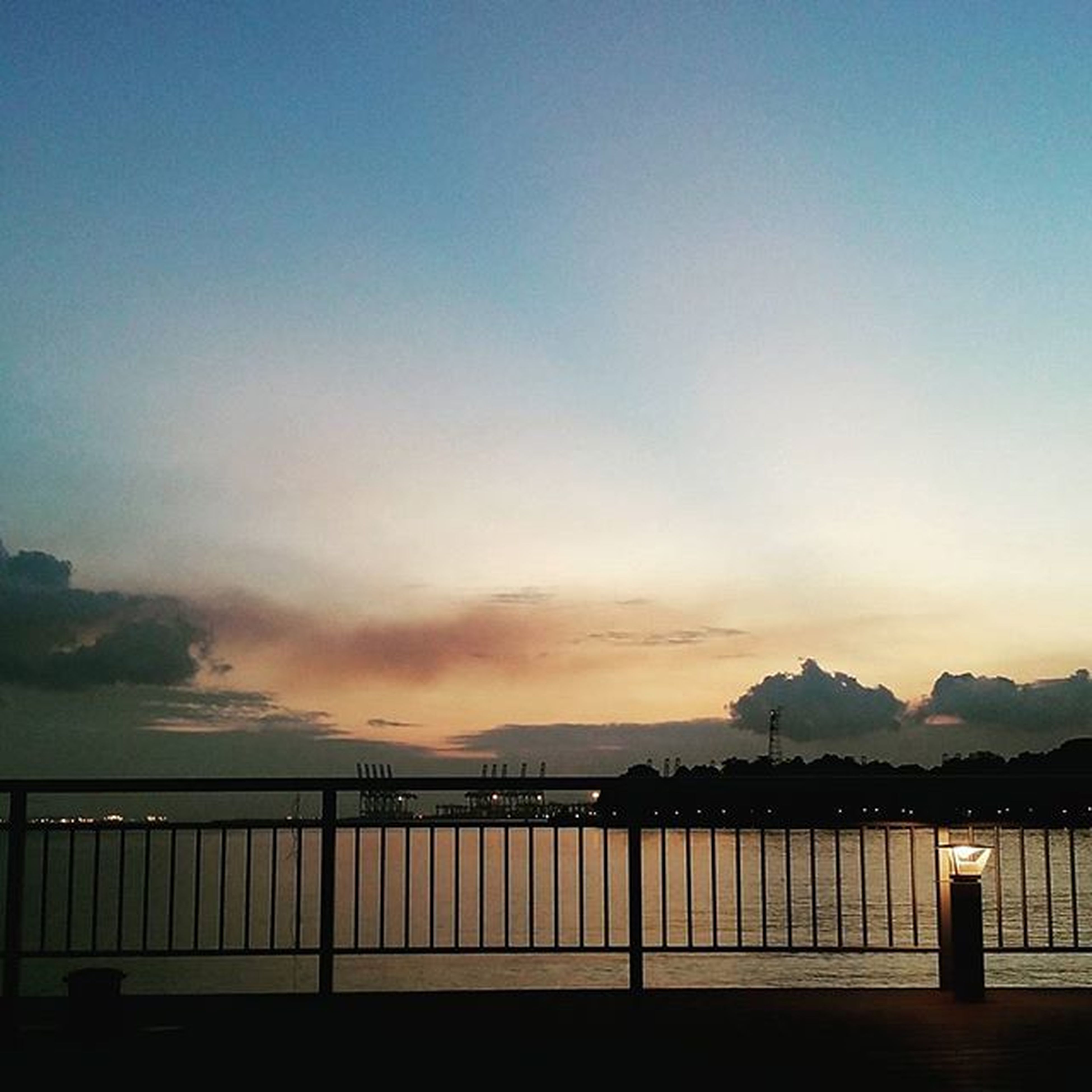 sunset, water, sea, railing, tranquility, tranquil scene, scenics, sky, silhouette, beauty in nature, mountain, dusk, nature, copy space, idyllic, pier, orange color, beach, outdoors, built structure