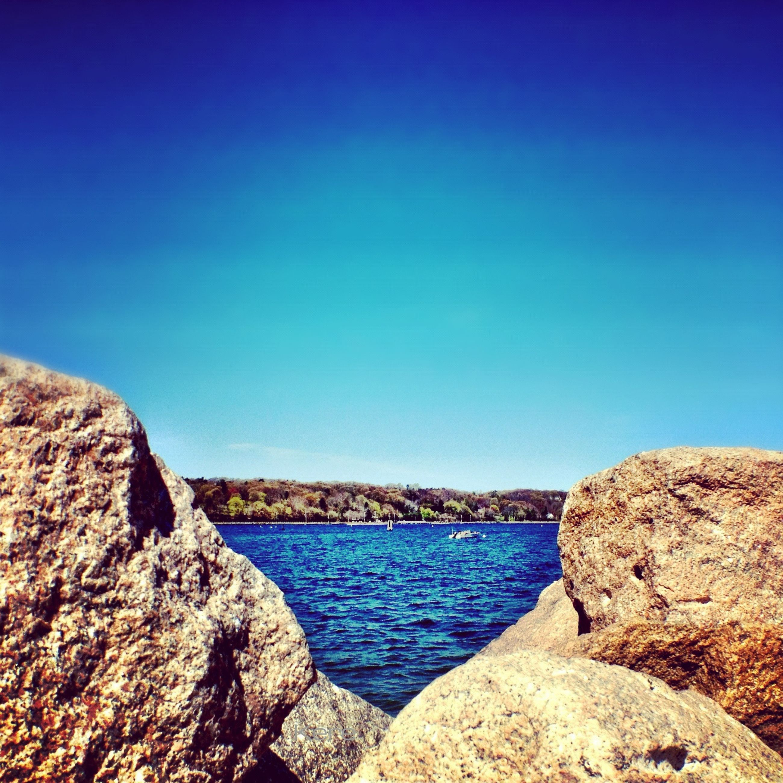blue, clear sky, water, copy space, tranquil scene, tranquility, scenics, sea, beauty in nature, rock - object, nature, rock, rock formation, idyllic, day, calm, outdoors, sunlight, no people, shore