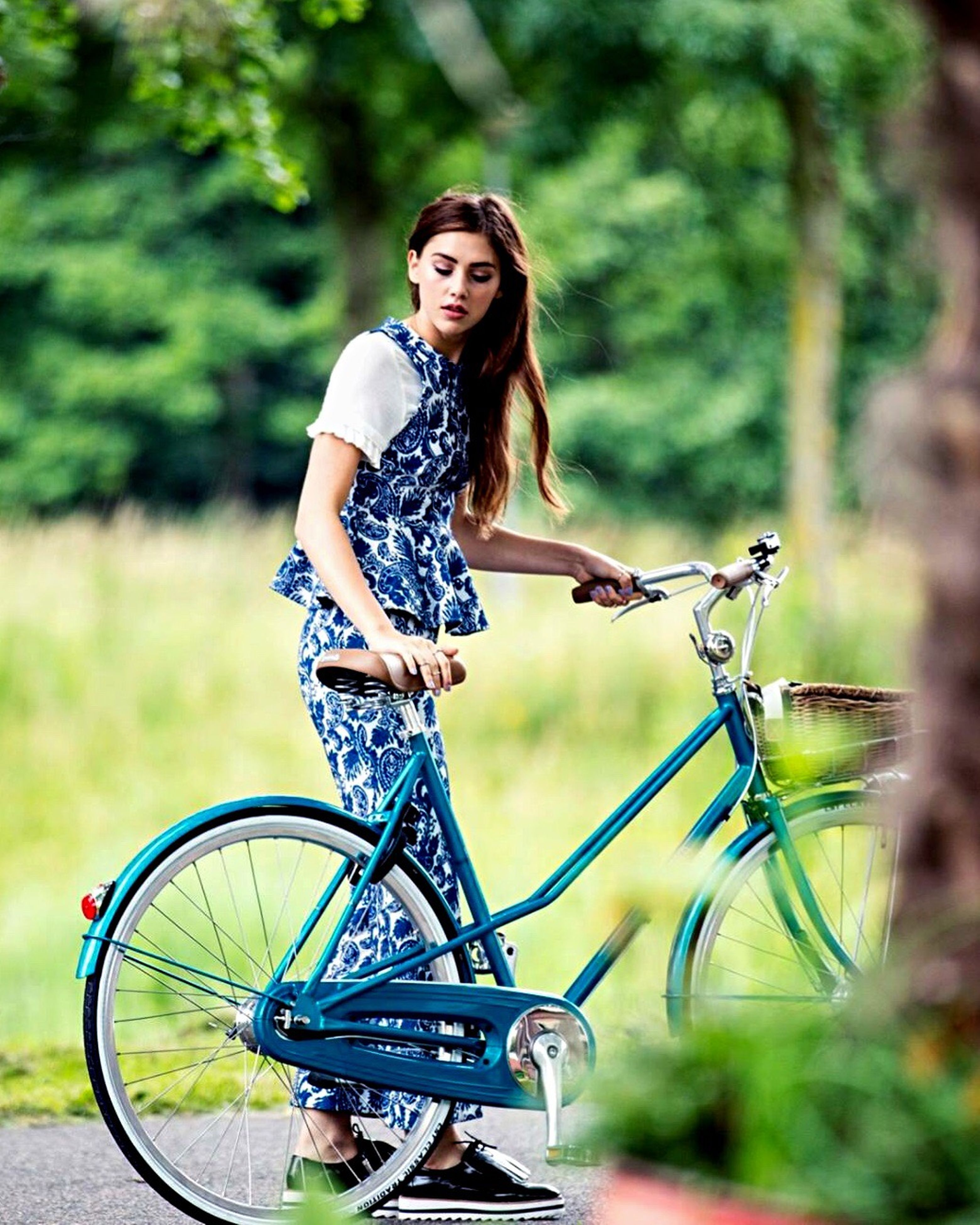 transportation, bicycle, young adult, mode of transport, leisure activity, travel, casual clothing, young women, lifestyles, focus on foreground, fruit, holding, smiling, person, front view, tourism, long hair, land vehicle, plant, looking at camera, vacations, posing