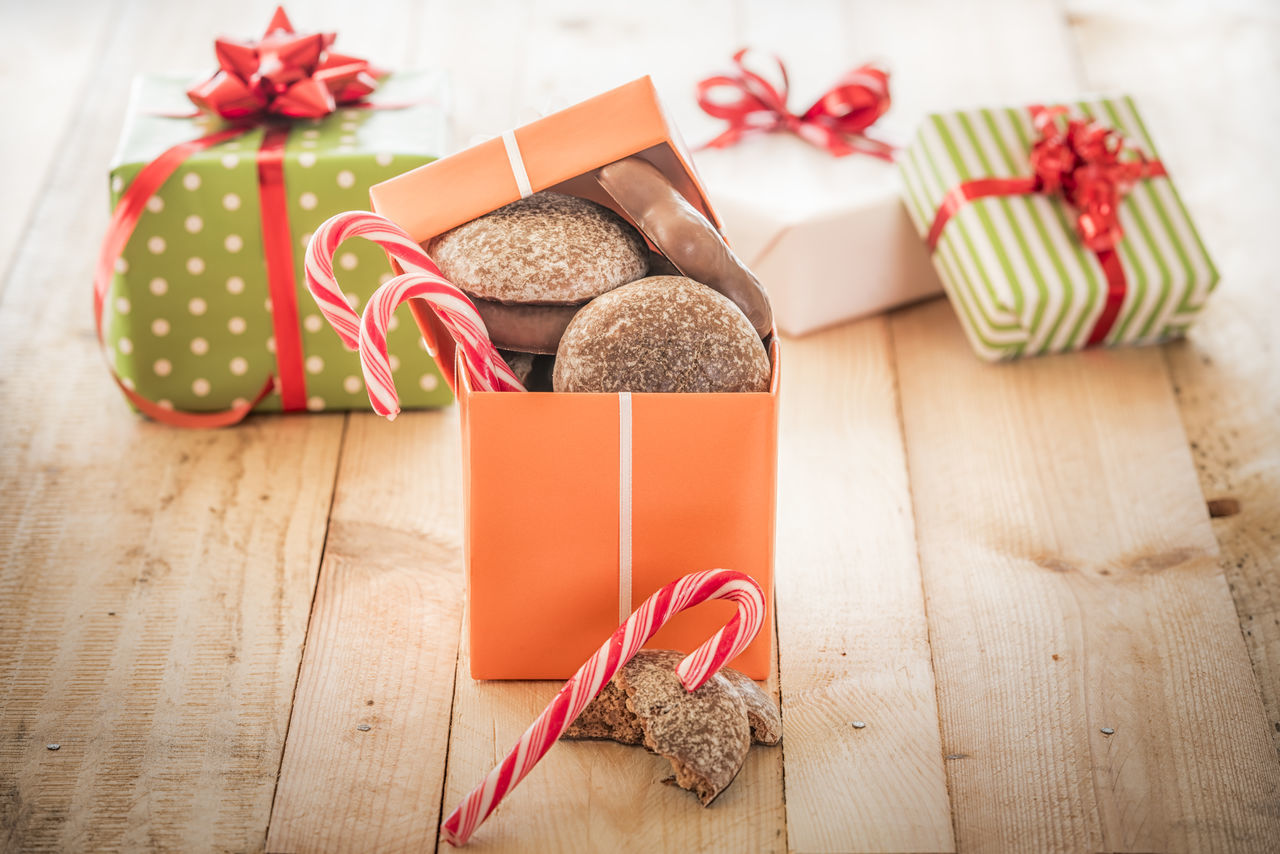 Orange colored gift box full of sweets, gingerbread and candies, on a wooden table Christmas Gifts Holiday Event Red Candies Wooden Table Celebration Christmas Christmas Decoration Christmas Present Family Gift Food Gift Gift Boxes Gingerbread Handmade Gifts Wrapped Gift Xmas Cookies