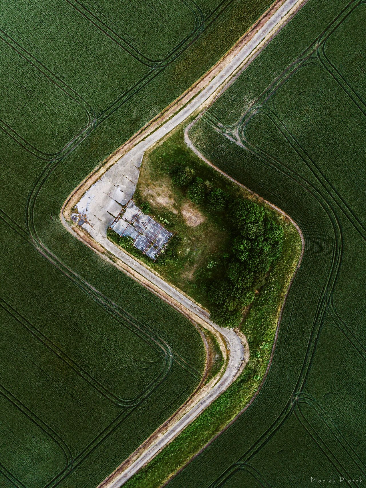Letters in Nature Aerial View Curve Road Winding Road Highway Transportation Car High Angle View No People Green Color Outdoors Nature Planet Earth Day City Sports Track