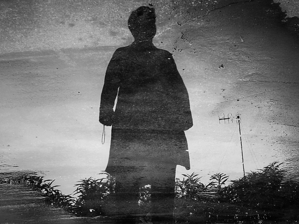 The Street Reflection. One Man Only Only Men One Person Silhouette People Water Real People Standing Full Length Outdoors Day Full Frame Headshot Human Eye Human Body Part Human Face EyeEmNewHere The Street Photographer - 2017 EyeEm Awards Street Photography Black & White Shadows & Lights Light And Shadow Reflections And Shadows Live For The Story Minimal Composition Let's Go. Together. EyeEm Selects