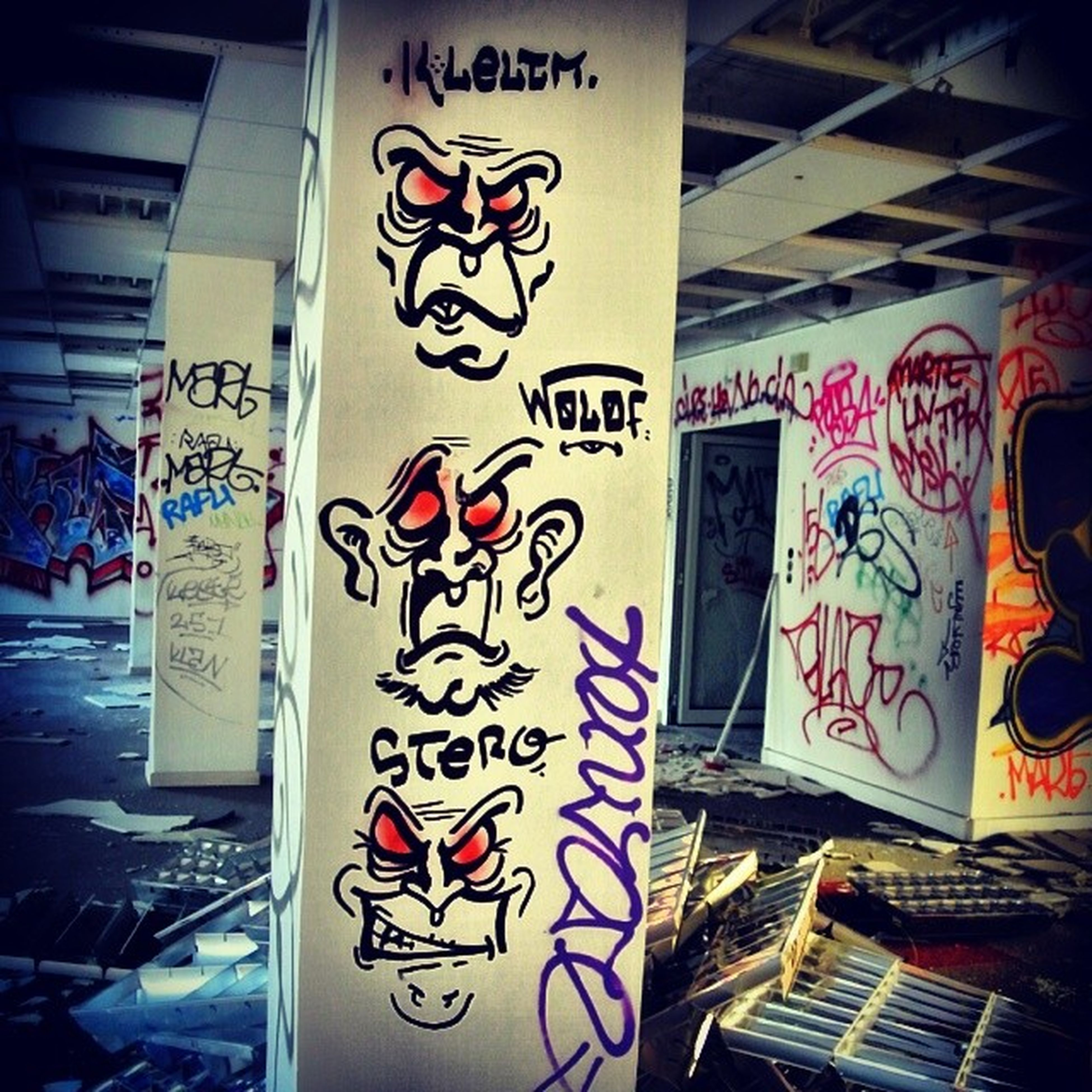 text, graffiti, western script, art, communication, creativity, wall - building feature, art and craft, built structure, architecture, indoors, street art, no people, capital letter, wall, non-western script, day, vandalism, building exterior, sunlight