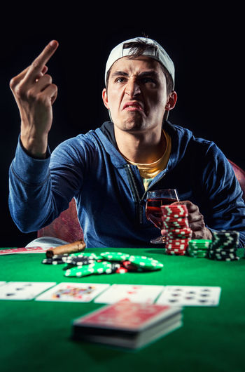 Poker player. Gambling concept Blackjack Casino Gambling Jackpot Man Poker Addiction Casino Entertainment Gambler Gambling Gambling Chip Game Gesture Leisure Activity Male One Person Player Playing Playing Card Games Poker - Card Game Poker Chips Poker Game Studio Shot Young Adult