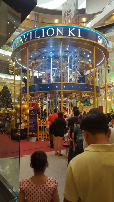Merry Go Round In Pavilon Crowd Kuala Lumpur Large Group Of People Littlefoodtrail Malaysia Merry Go Round Merrygoround Pavilon