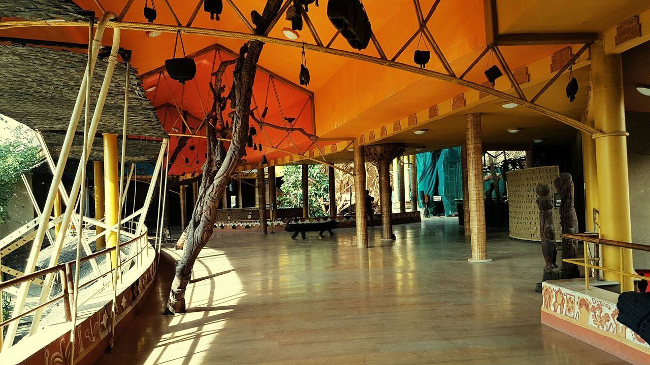 hanging, built structure, indoors, day, no people, architecture