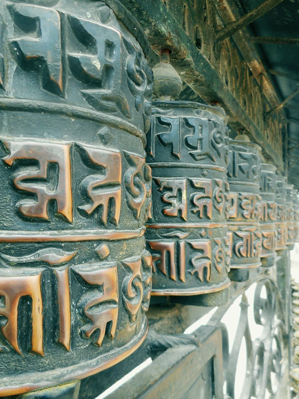 text, architecture, metal, religion, carving - craft product, built structure, spirituality, no people, outdoors, day, close-up, building exterior