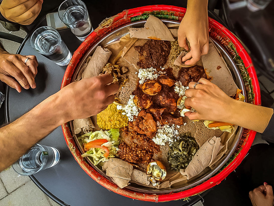 Food Brings People Together Close-up Dish Eating Eating With Friends Eating With Hand Ethiopian Food ShareTheMeal Food Sharing Foodie Foodphotography Group Of People Hands Lifestyles Meeting Friends People Together Ready-to-eat Sharing A Moment Sharing Food