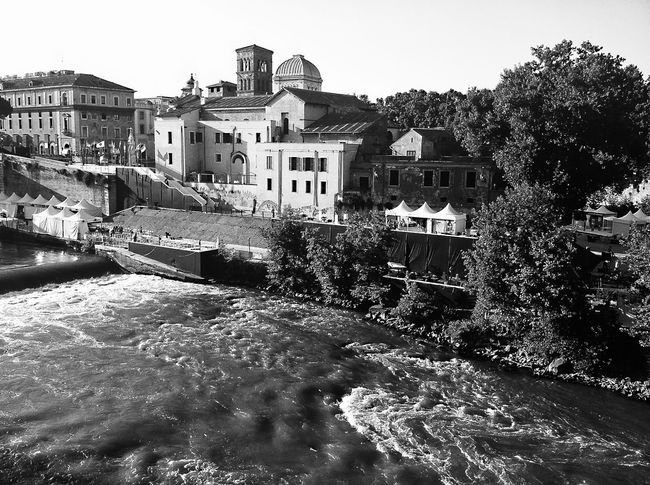 Architecture Building Exterior Built Structure Culture Famous Place Human Settlement Isola Tiberina Italy Motion Outdoors Rippled River Rome Splashing Tevere River Tourism Water Waterfall