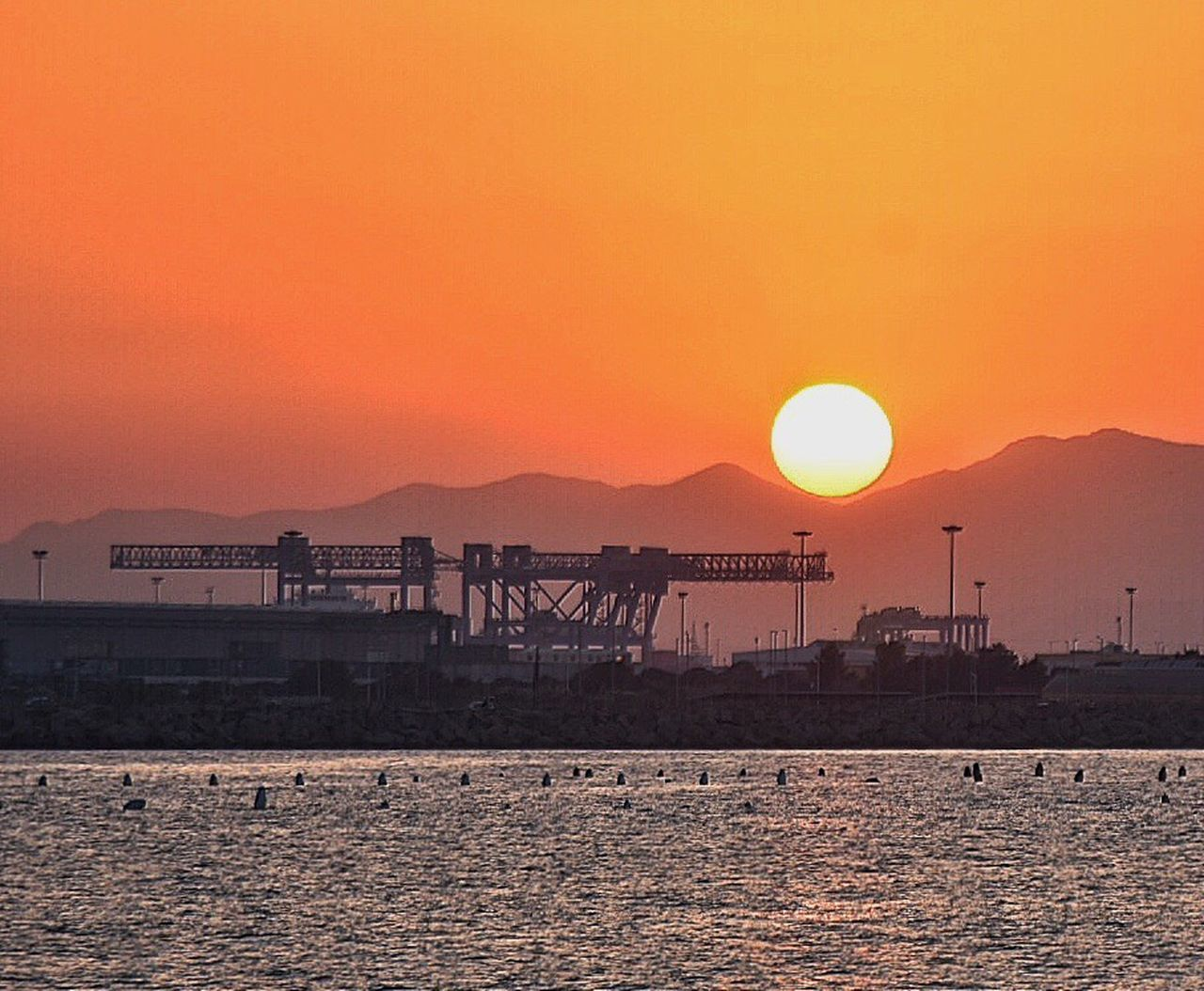 Sunset Water Sun Scenics Silhouette Waterfront Tranquil Scene Orange Color Tranquility Mountain Idyllic Sea Vacations Majestic Atmosphere Beauty In Nature Non-urban Scene Moody Sky Industry Calm Mare Cagliari Water Reflections Cagliari Urban City Sardinia Sardegna Italy