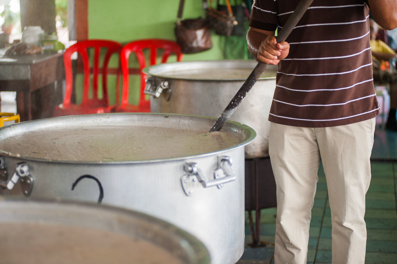 Cooking bubur lambuk Casual Clothing Close-up Cooking Cropped Day Focus On Foreground Leisure Activity Lifestyles Midsection Part Of Preparation  Selective Focus Skill  Unrecognizable Person