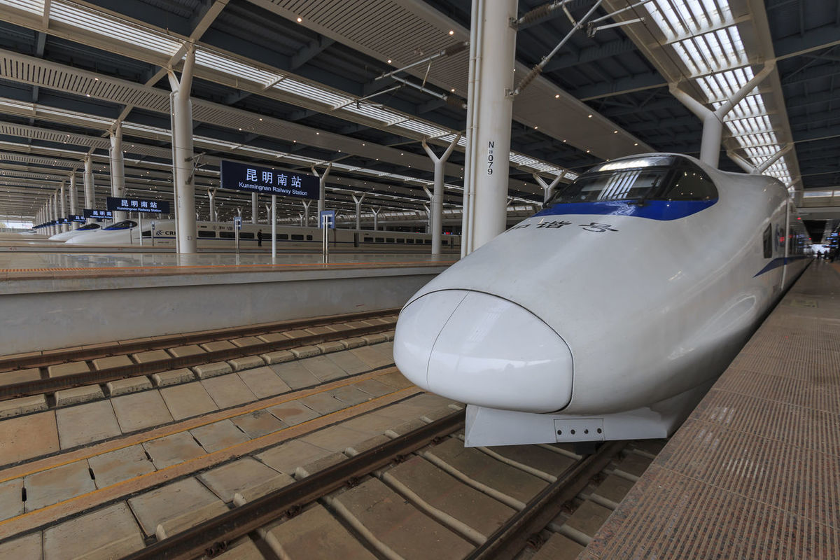Kunming, China - March 29, 2017: Close up of a Chinese fast train inside the newly opened high speed train station in Kunming. The new fast train station links Kunming to Beijing, Shanghai and Guangzhou Aerospace Industry Air Vehicle Airplane Airport ASIA Beijing Bullet Train China Cockpit Commercial Airplane Fast Train Futuristic Gaotie Guangzhou High Speed Train Indoors  Kunming,Yunnan,China No People Shanghai Shinkansen Stationary Technology Train Station Transportation Yunnan