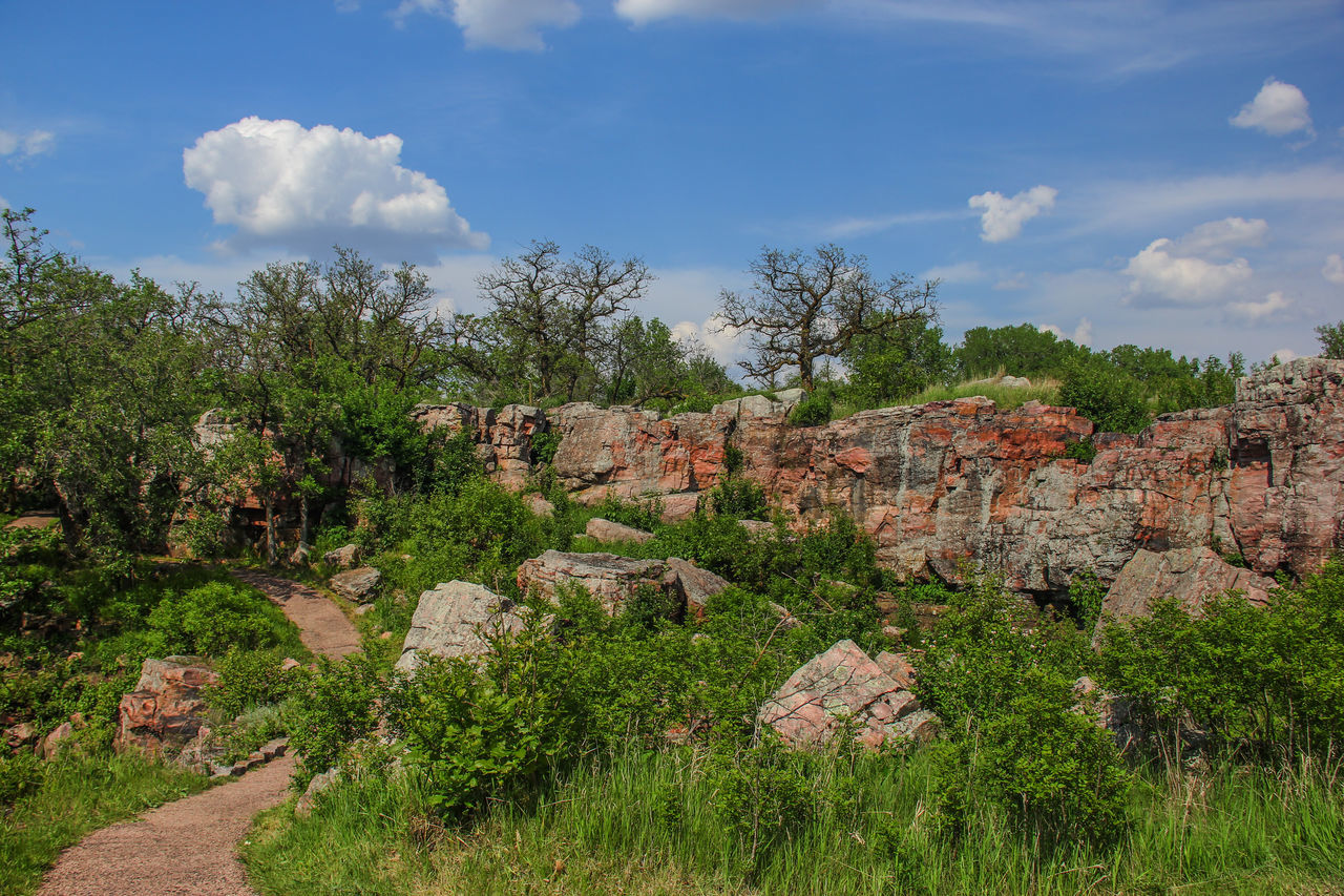 Rock outcropping at Pipestone National Monument. Blue Sky Canon60d Canonphotography Clouds EyeEm Gallery Grass Green Path Pipestone Pipestone National Monument Rock Rock Formation Rock Outcrop Stone Summer Trees Walkway