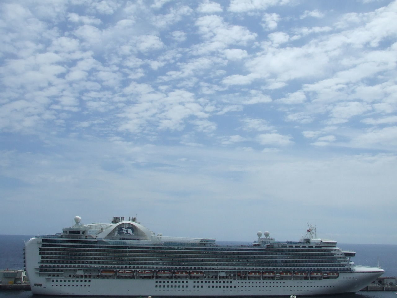cloud - sky, sky, transportation, nautical vessel, day, outdoors, mode of transport, cruise ship, ship, no people, low angle view, building exterior, water, architecture, nature