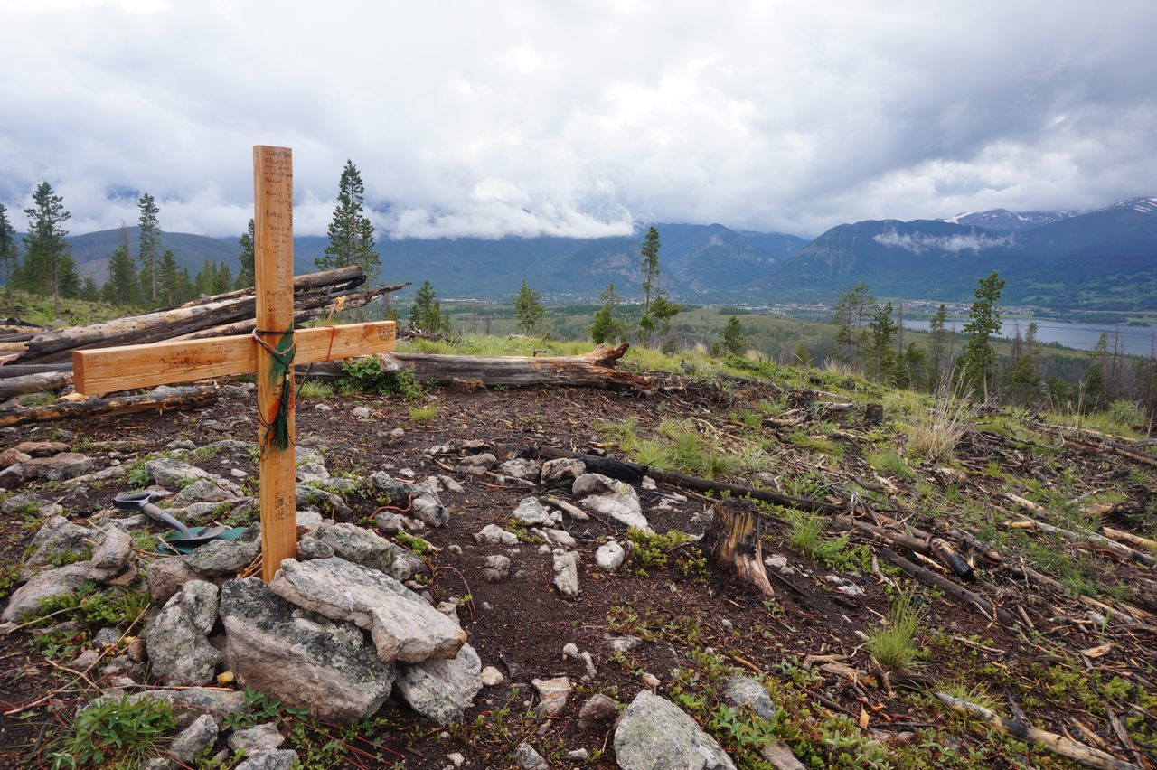"""The Photojournalist - 2015 EyeEm Awards When you get to the top of Sapphire Point, in the Rocky Mountains, it seems as if you've reached a level of heaven that's nearly indescribable. You realize and see things that you'd never believe in your wildest dreams you'd see. The cross is covered in messages left for the deceased. Being that it is one of the most beautiful places on earth, even Angels would want to come back down to earth just to take a """"peak""""."""