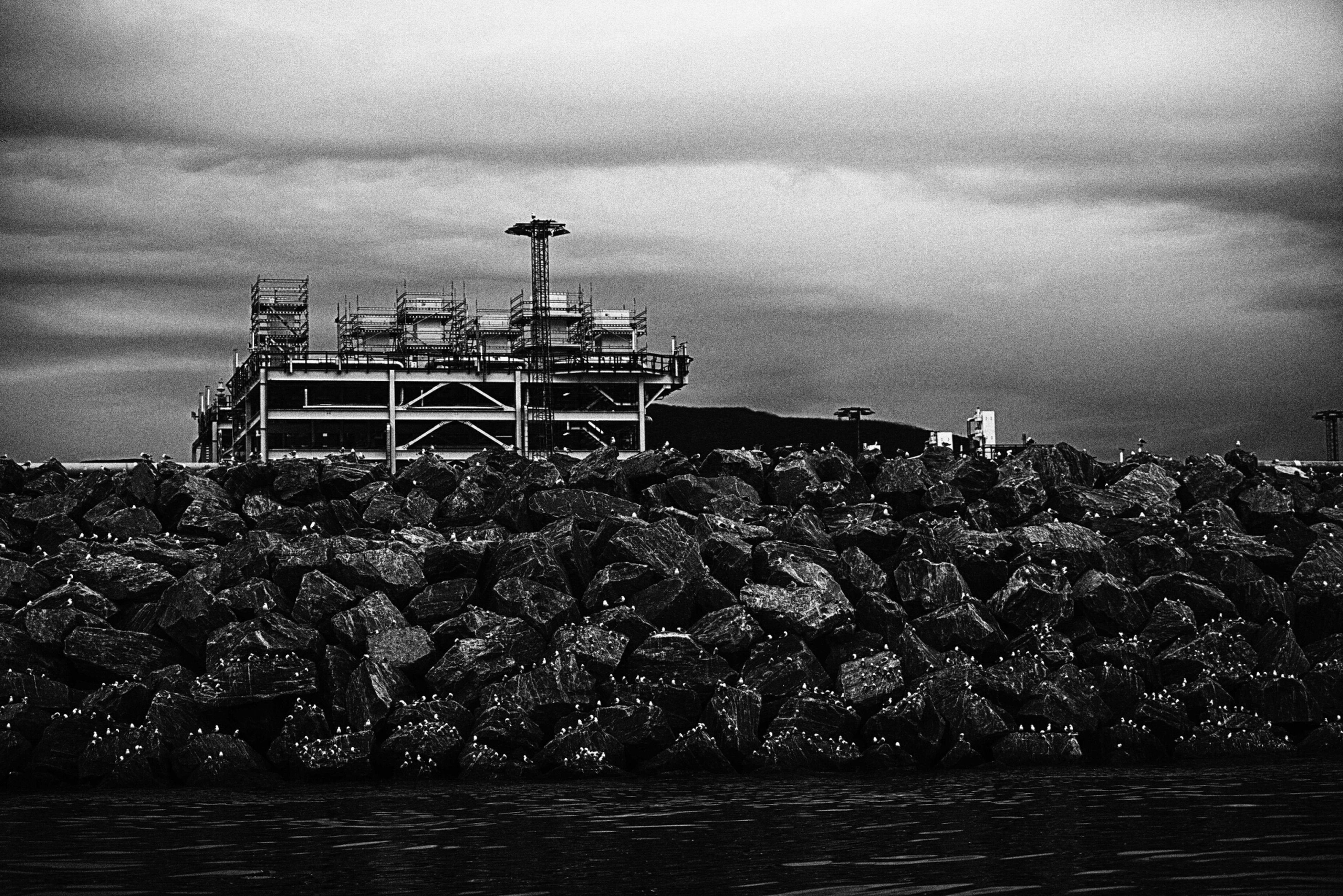sky, water, built structure, building exterior, cloud - sky, architecture, weather, cloudy, overcast, waterfront, nature, no people, sea, outdoors, day, dusk, cloud, industry, river, lake