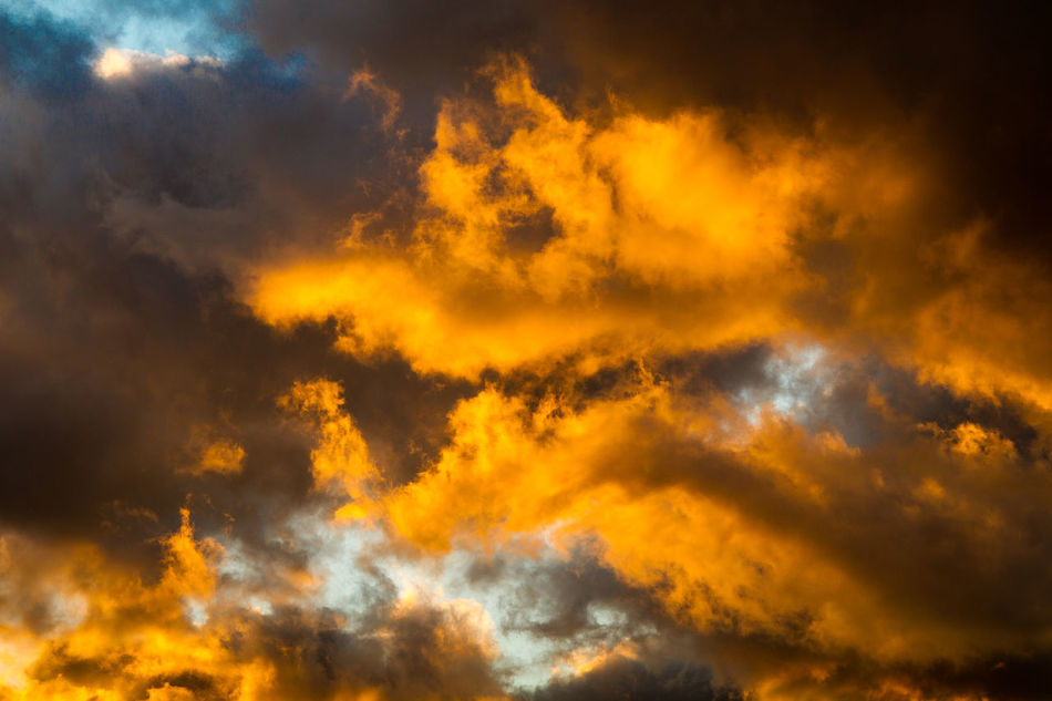 Backgrounds Beauty In Nature Burning Cloud - Sky Clouds Cloudscape Dramatic Sky Dusk Sky Heat - Temperature Low Angle View Nature No People Orange Color Outdoors Scenics Sky Sunset Yellow