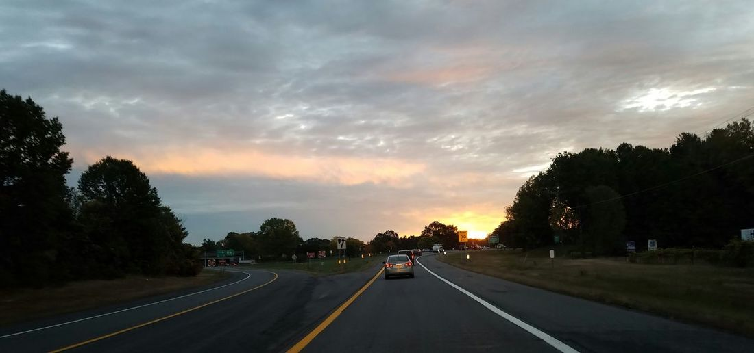 Transportation Road The Way Forward Car Tree Sky Mode Of Transport Road Marking Land Vehicle Cloud Cloud - Sky Vanishing Point Tranquil Scene Cloudy Nature Outdoors Solitude On The Way To Work Sunrise Samsung Galaxy S7 Edge Samsung Photography Photo From My Truck