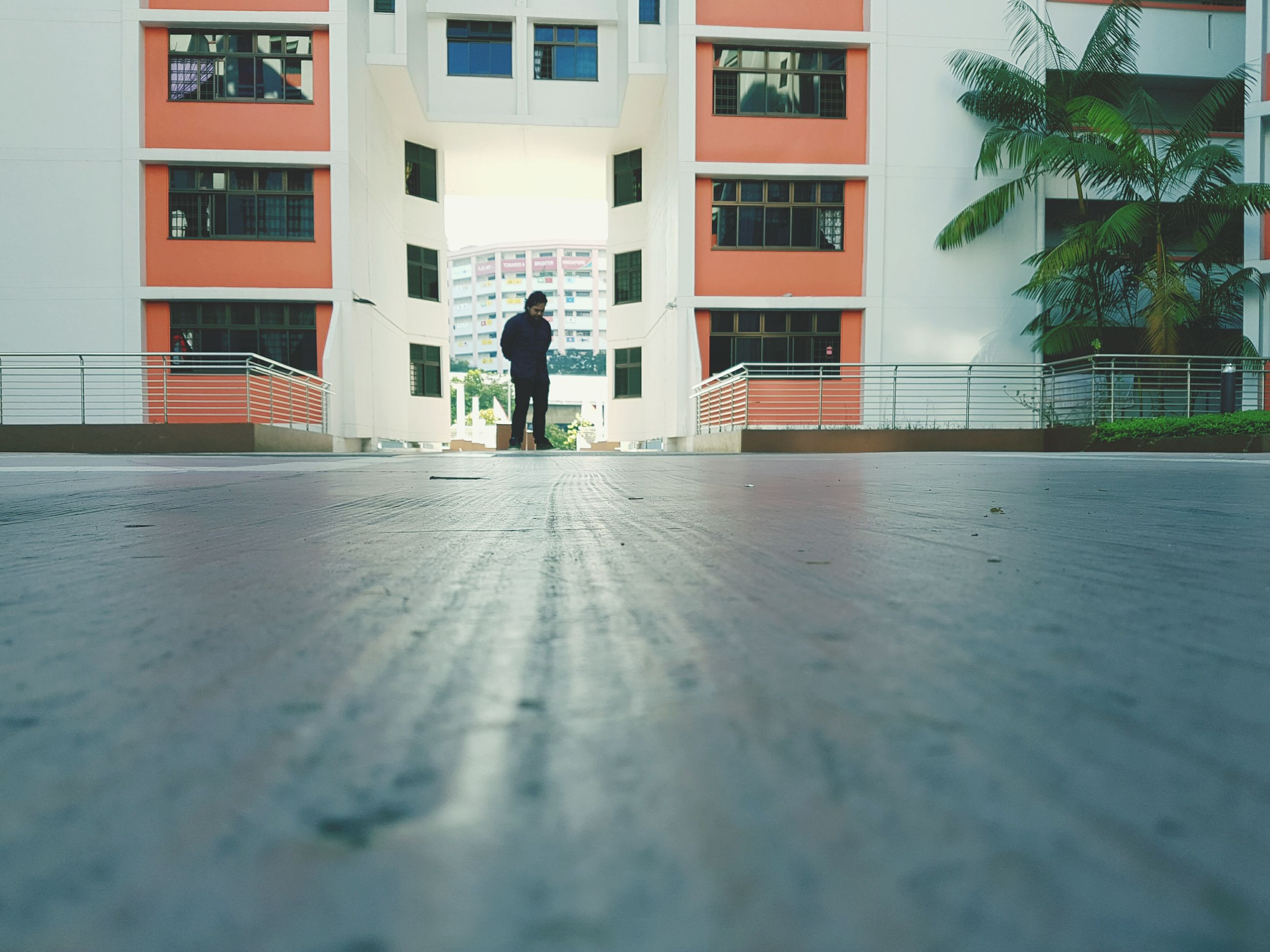 building exterior, architecture, built structure, men, full length, city, day, person, outdoors, paving stone, the way forward, surface level, footpath, city life, residential district