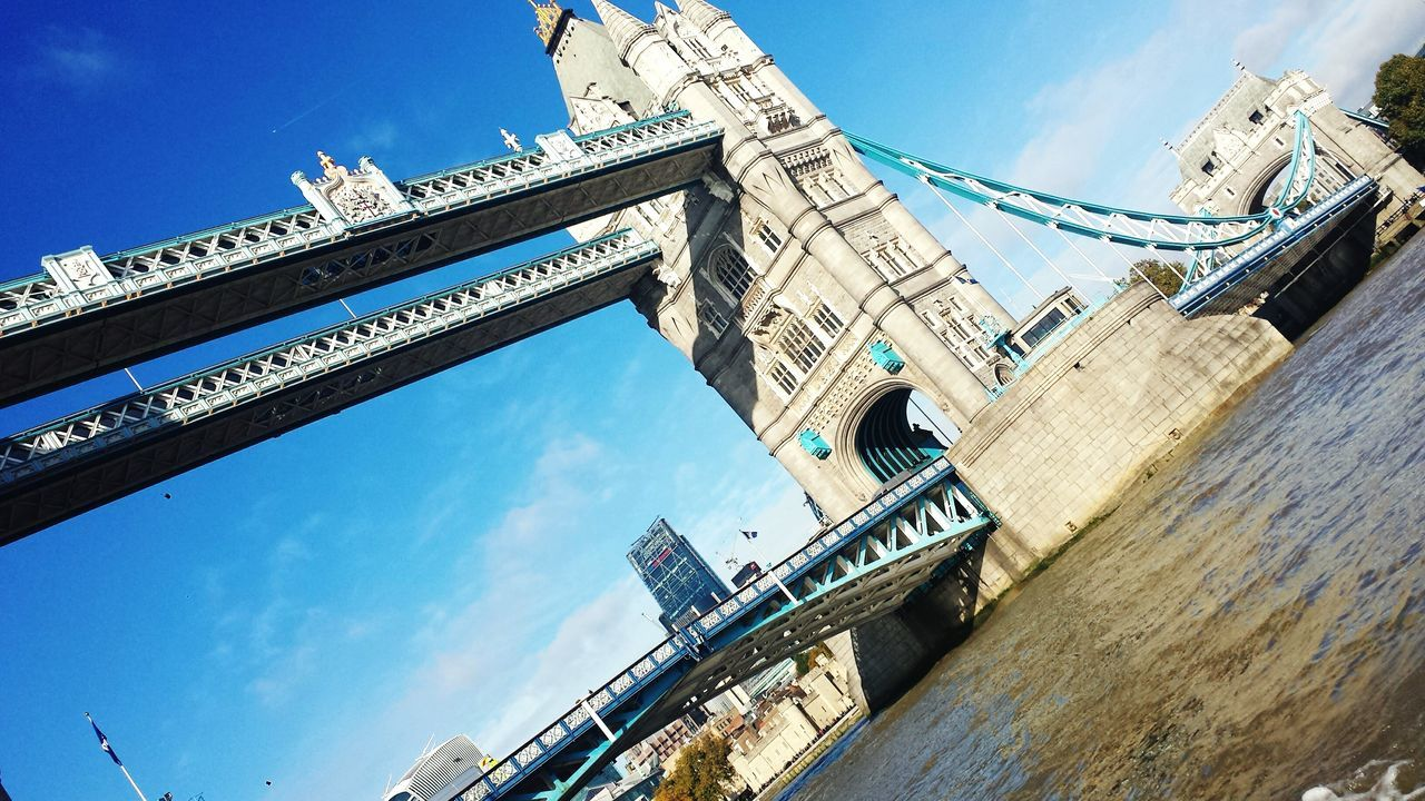 architecture, low angle view, built structure, sky, connection, day, bridge - man made structure, outdoors, building exterior, no people