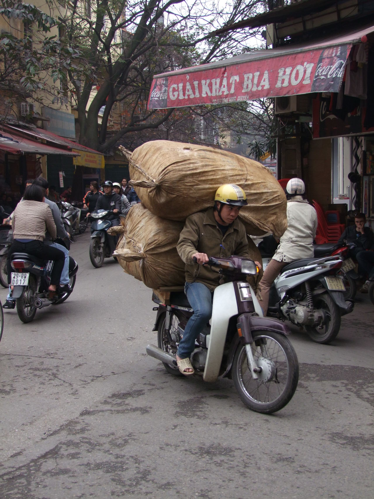Overladen Scooter! City City Life Composition Culture Dangerous Day Full Frame Full Length Hanoi Incidental People Laden Land Vehicle Lifestyles Mode Of Transport Motorcycle On The Move Outdoor Photography Rider Riding Scooter Street Transportation Vietnam Young Man