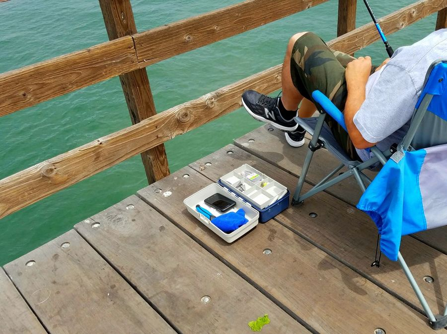 Cellphone In Fishing Box Fishing Equipment Funny Smartphone Lure Fishing Equipment Nature Vacations Freedom Bonding Friendship Ocean Pier Togetherness Copyspace Background Meditation Enjoying Life Sea Scenics Strength Leisure Activity Lets Go. Together. Sommergefühle Breathing Space