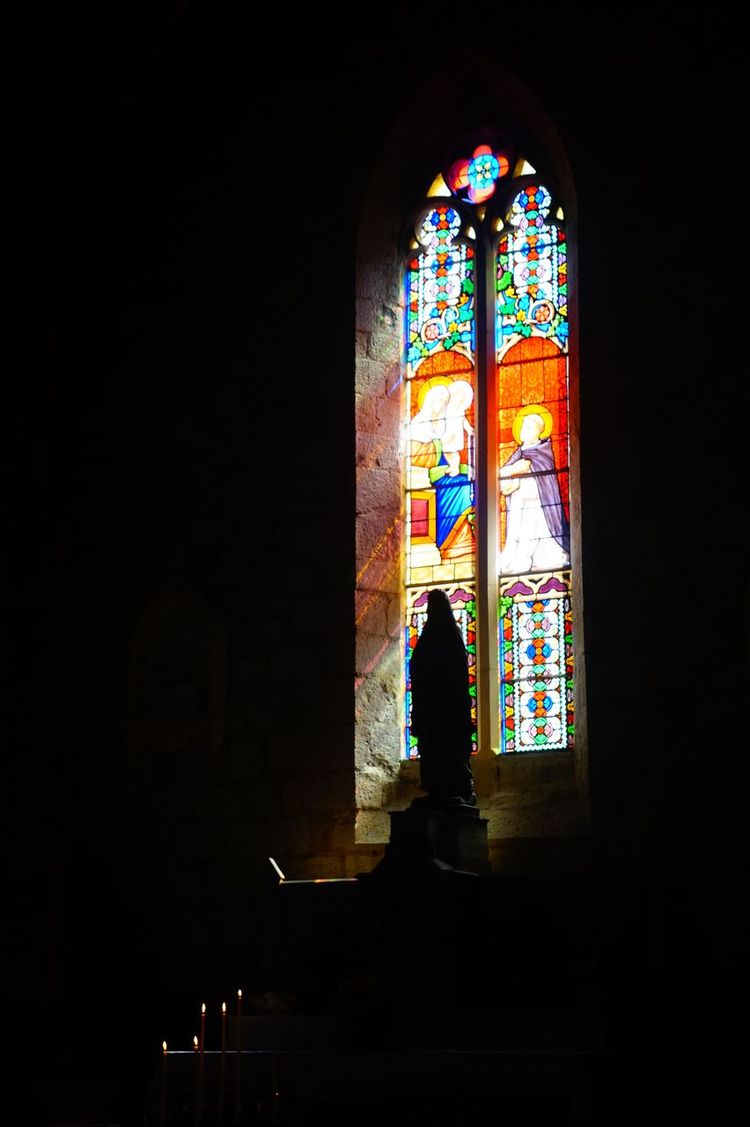 Candles Church Church Window Stained Glass Sunlight Architecture Built Structure Day Indoors  No People Place Of Worship Religion Spirituality Stained Glass Window Statue Monpazier. France . The Week On EyeEm Your Ticket To Europe