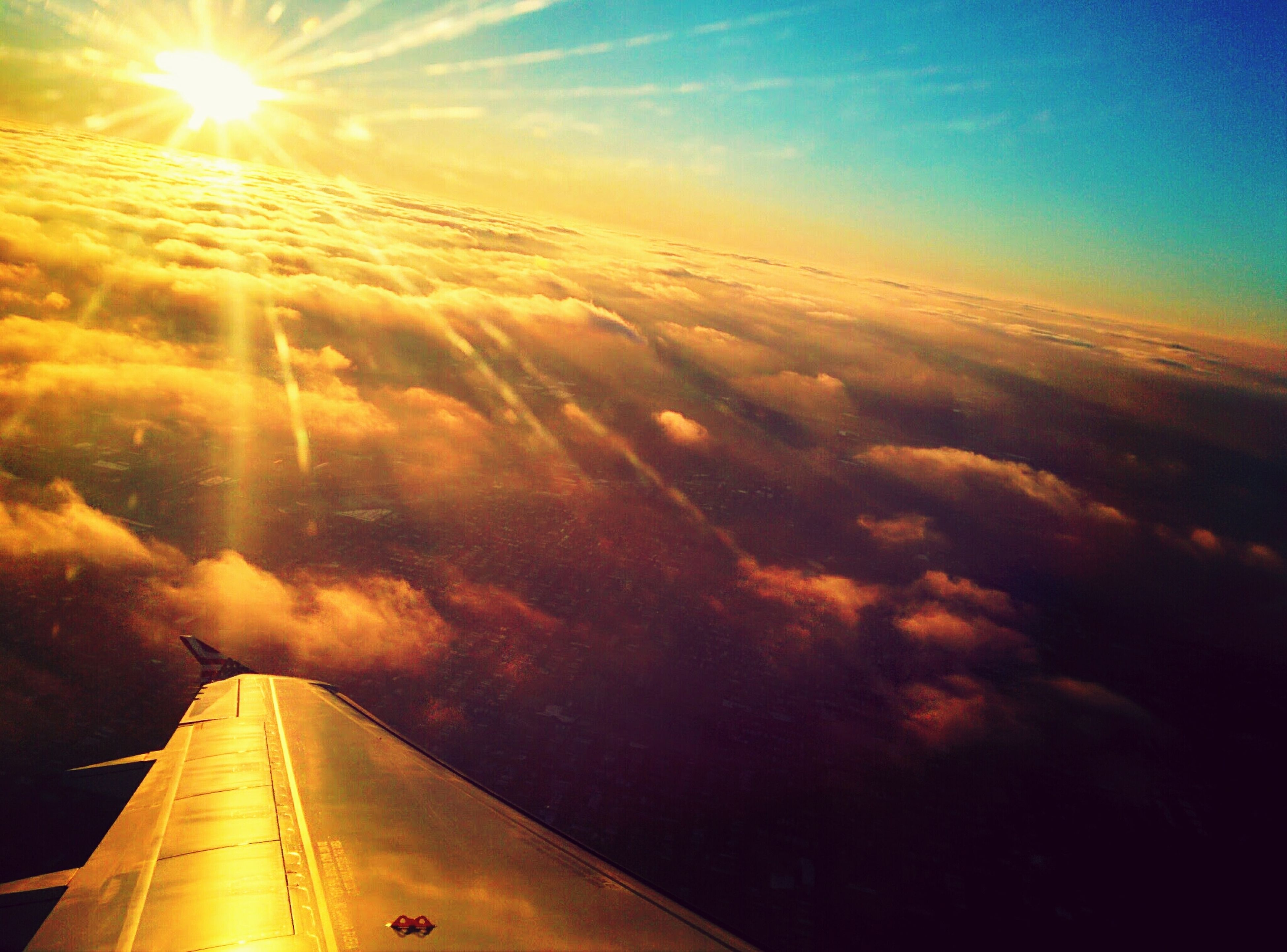 transportation, airplane, mode of transport, aircraft wing, sky, air vehicle, flying, aerial view, sunset, part of, cloud - sky, on the move, sun, cropped, travel, scenics, beauty in nature, sunlight, journey, nature