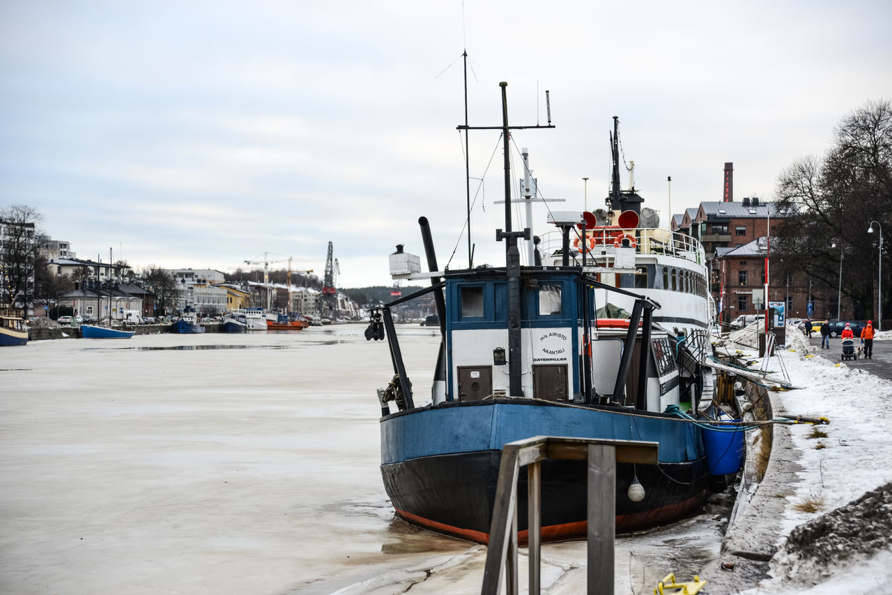Moored boat at the Aura River bank Aura River Boat Built Structure Cloud - Sky Day Ice Ice Covered  Moored Nautical Vessel No People Outdoors River Sky Snow Transportation Water Winter