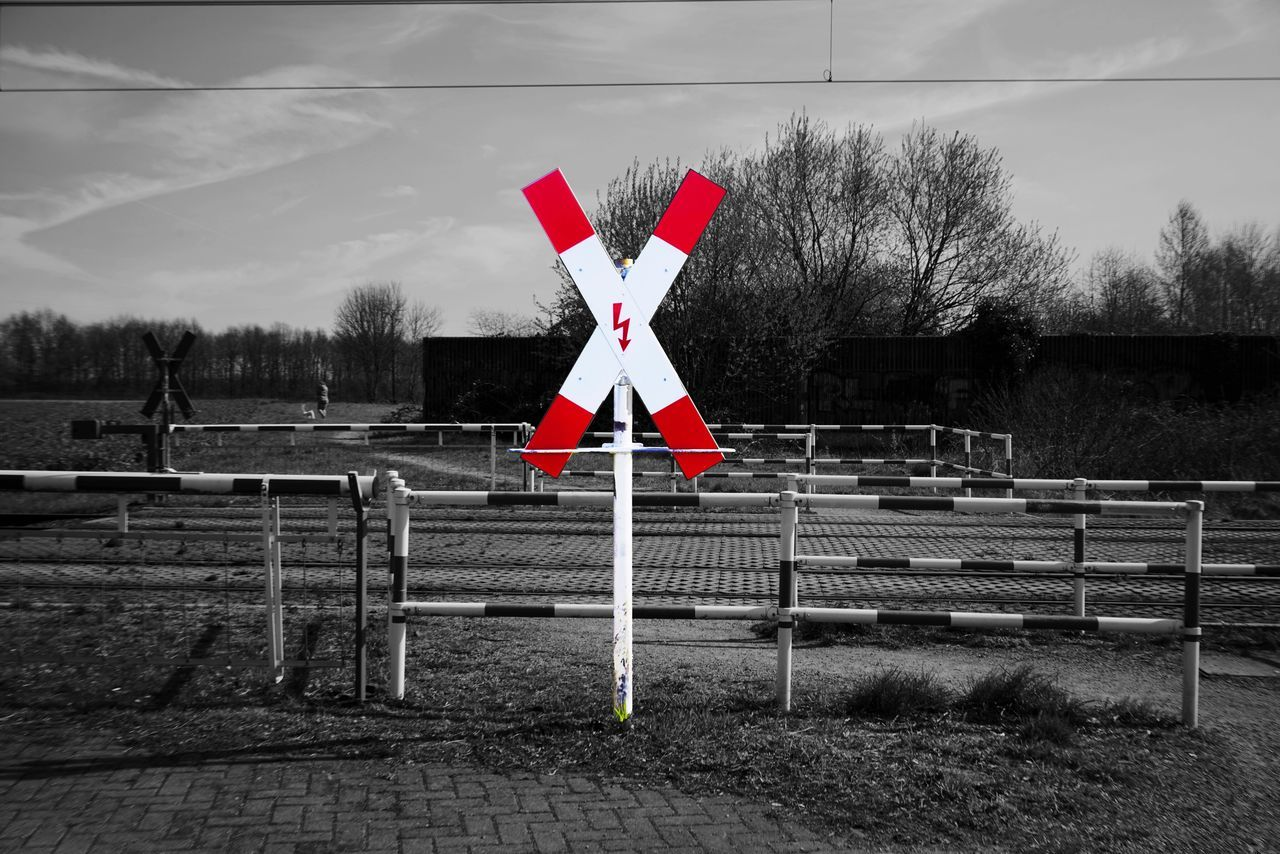 Railroad Crossing Warning Sign No People Outdoors Cross Shape Tree Crossing Sign Sky Nature Road Sign Road Day Landscape