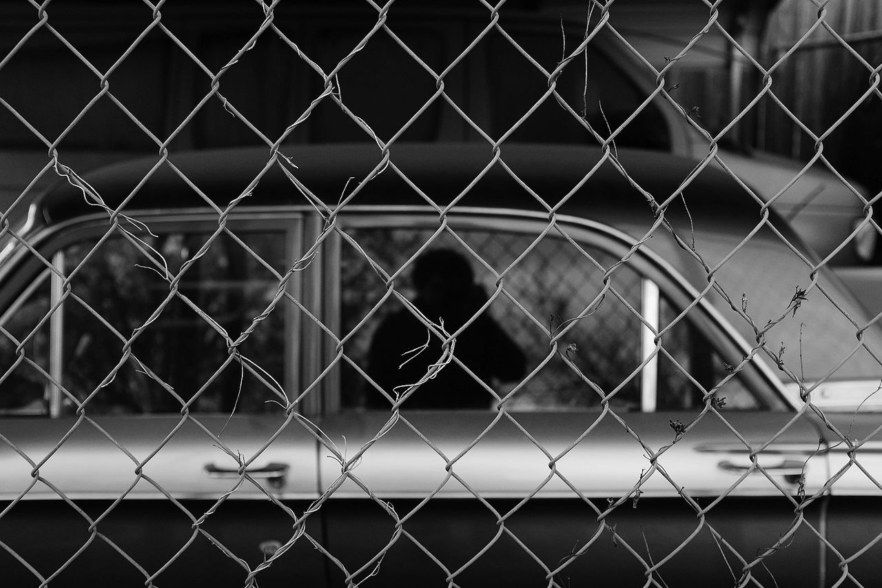 It me. Chainlink Fence Fence Protection Safety No People Metal Full Frame Outdoors Pattern Backgrounds Close-up Classic Car Classic Cars Welcome To Black Black & White Reflection Windows
