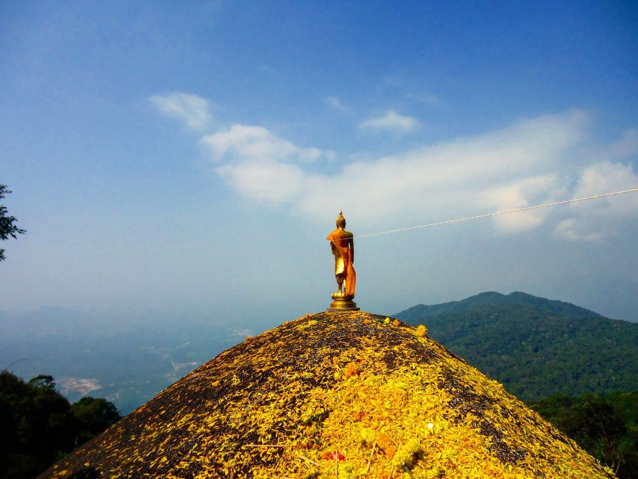 mountain, nature, sky, beauty in nature, spirituality, religion, tranquil scene, arms outstretched, outdoors, cross, tranquility, standing, day, low angle view, cloud - sky, scenics, hiking, real people, one person, adventure, people