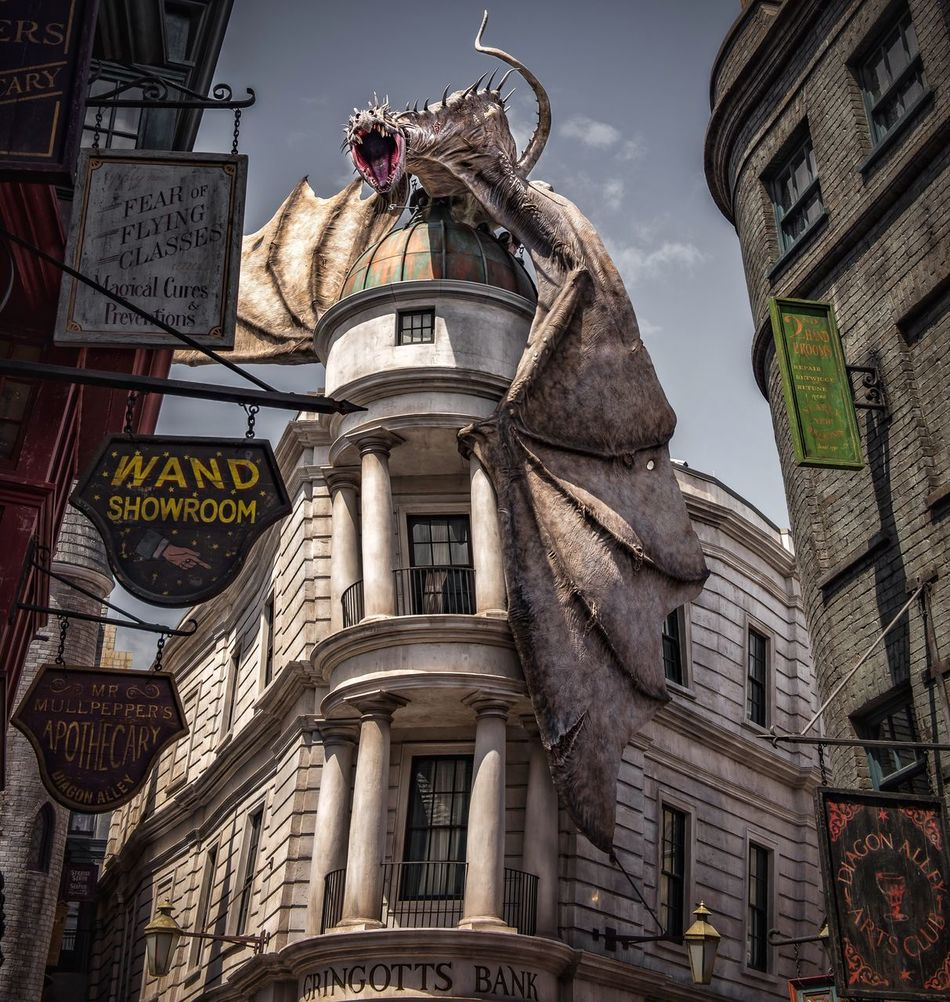 Diagon Alley Building Exterior Architecture Built Structure Low Angle View City Sky Outdoors No People Day Clock Sculpture Clock Tower
