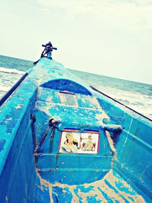 boats at Tuticorin Harbour Beach by Rockie Mech