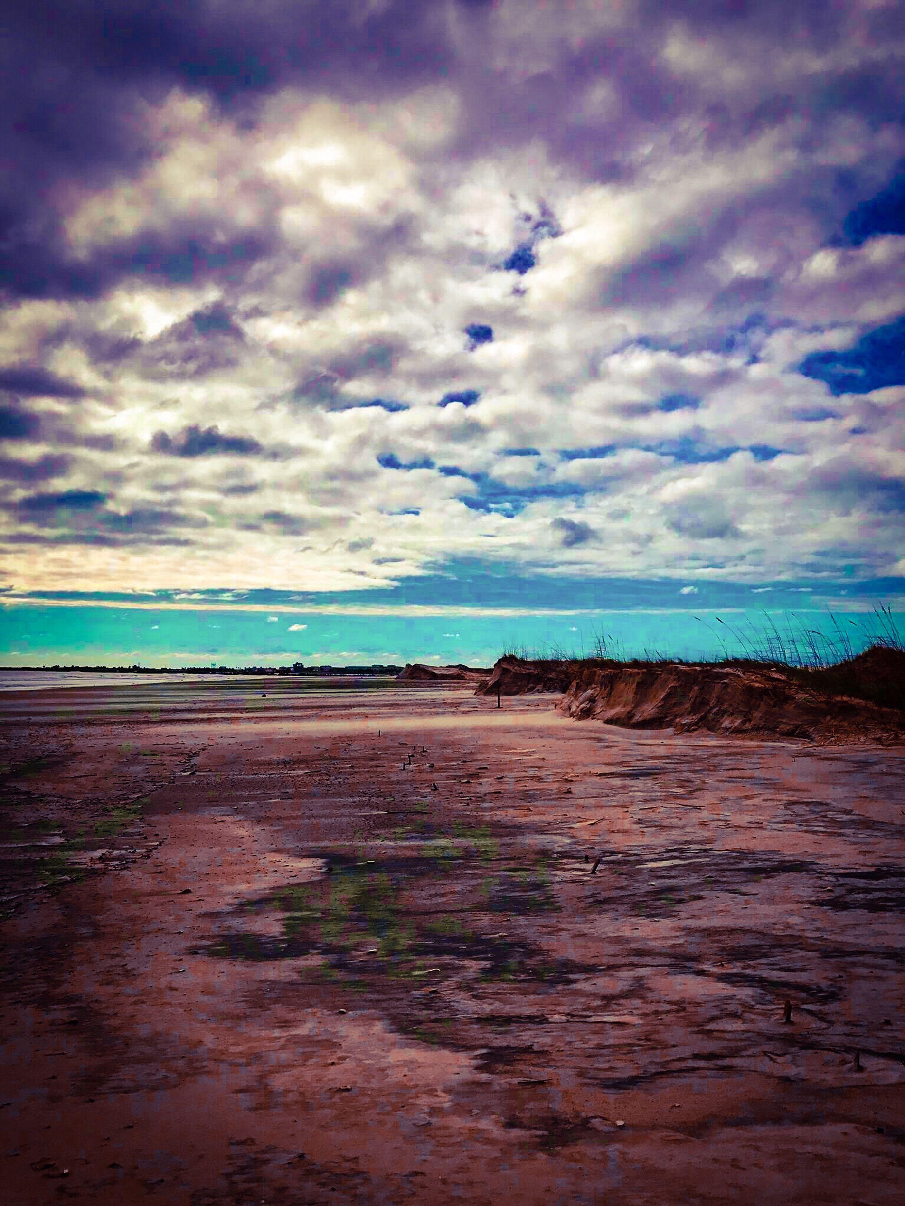 sea, horizon over water, water, beach, tranquil scene, sky, scenics, tranquility, calm, beauty in nature, cloud - sky, shore, blue, cloud, sand, idyllic, nature, coastline, ocean, atmospheric mood, cloudy, majestic, non-urban scene, day, seascape, remote, solitude, coastal feature, outdoors, horizon, dramatic sky, tourism, cloudscape, atmosphere