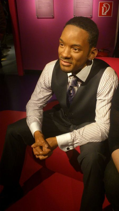 Indoors  Lifestyles Person Relaxation Sitting Smiling Three Quarter Length Wax Museum Will Smith Young Adult Young Men