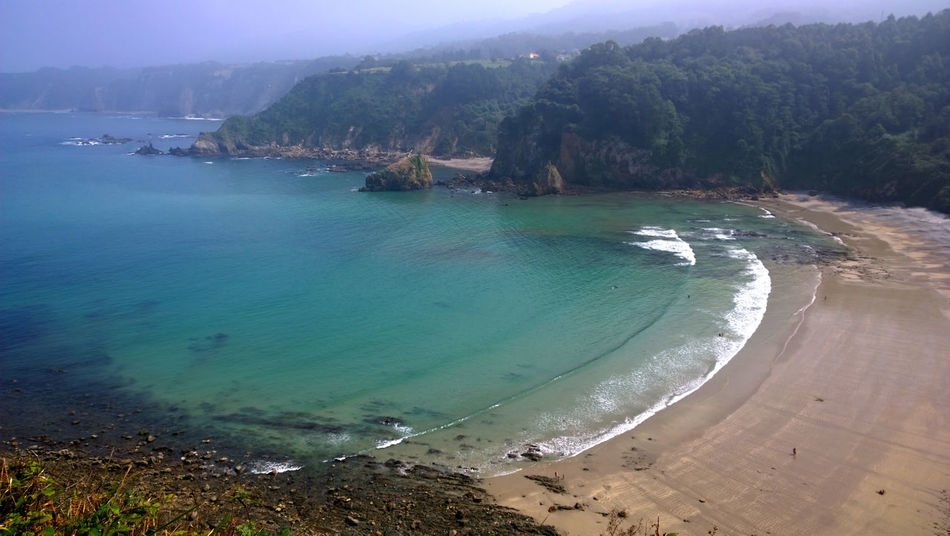 Landscape of the Beach of Cadavedo in Asturias - Spain Aerial View Asturias Beach Cadavedo Cantabrian Sea Coast Coastline Coastline Landscape Mountain Nature Ocean Outdoors Picturesque Sand Scenics Sea Sea View Seascape Shore Tourism Tranquility Travel Water Wave