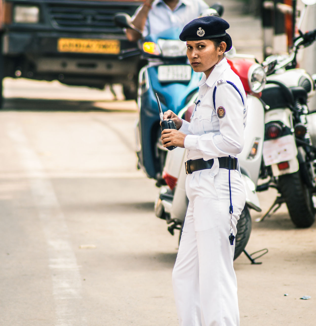 The temperature can never stop these brave hearts from guilding us. Traffic Police  Indian Police Woman Young Adult One Person Portable Information Device Wireless Technology Communication Adults Only City Technology Outdoors People One Man Only Human Body Part Lifestyles Warm Day Hard Working Girl Guild Mobile Phone Smart Phone Day Daylight Adult in Guwahati Assam, India Break The Mold Art Is Everywhere Art Is Everywhere