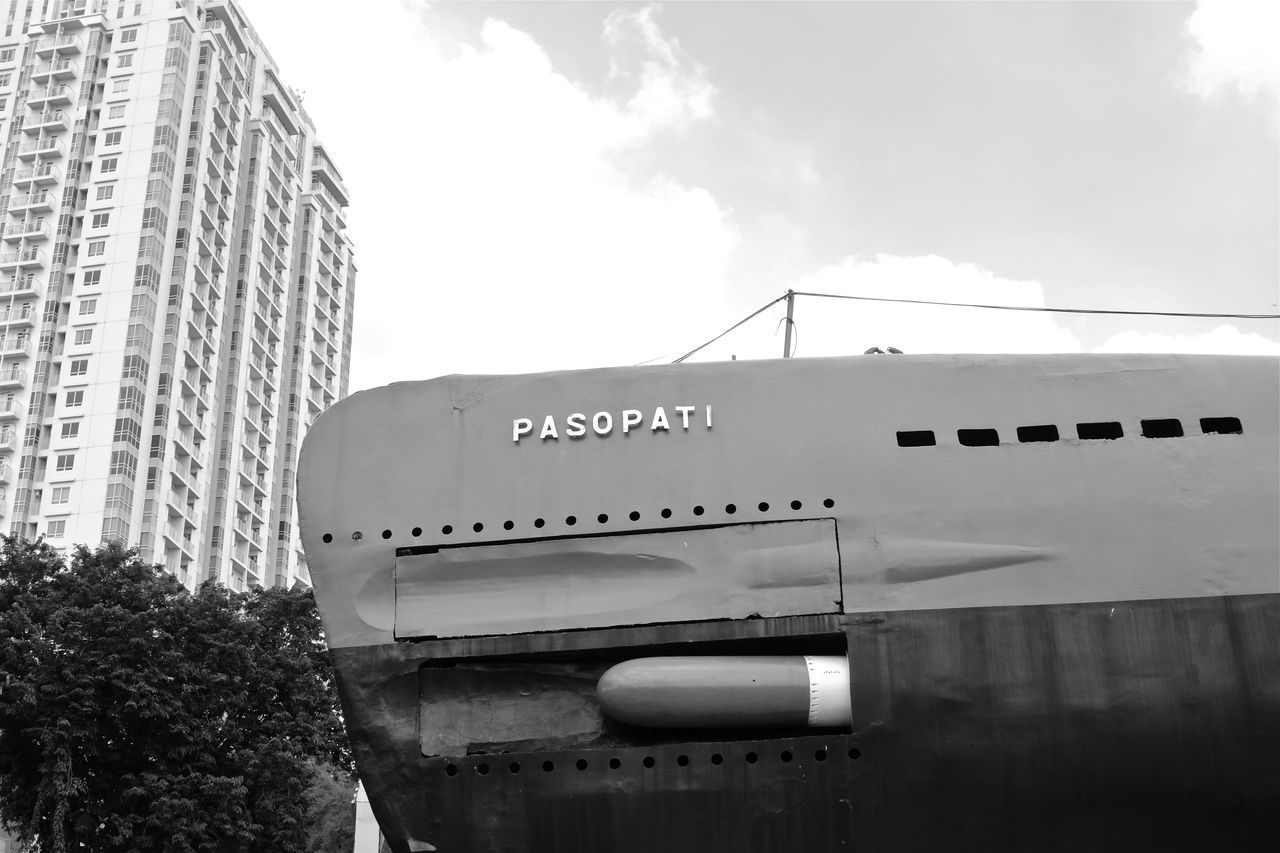 the irony of it all Adapted To The City Built Structure Copy Space Daytime Fujifilm_xseries High Rise Building INDONESIA Ironic  Juxtaposition Landscape Landscape_Collection Military Naval New Topographics No People Outdoors Skyscraper Street Photography Submarine Surabaya Urban Urban Geometry Urban Landscape