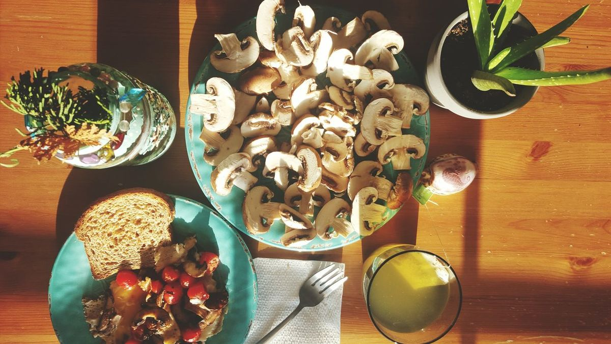 Healthy breakfast. Cooked eggs, multi grain bread, tomatoes and mushrooms cooked on the skillet without oil. Table Still Life Wood - Material Indoors  Directly Above Large Group Of Objects Food And Drink Food Close-up Freshness Sweet Food Eggs For Breakfast Breakfast Nutrients Superfood Nutritional Supplement Healthy Lifestyle Grape Tomatoes Mushrooms Green Tea Vegetables Eggs Ready-to-eat Sunlight Plate