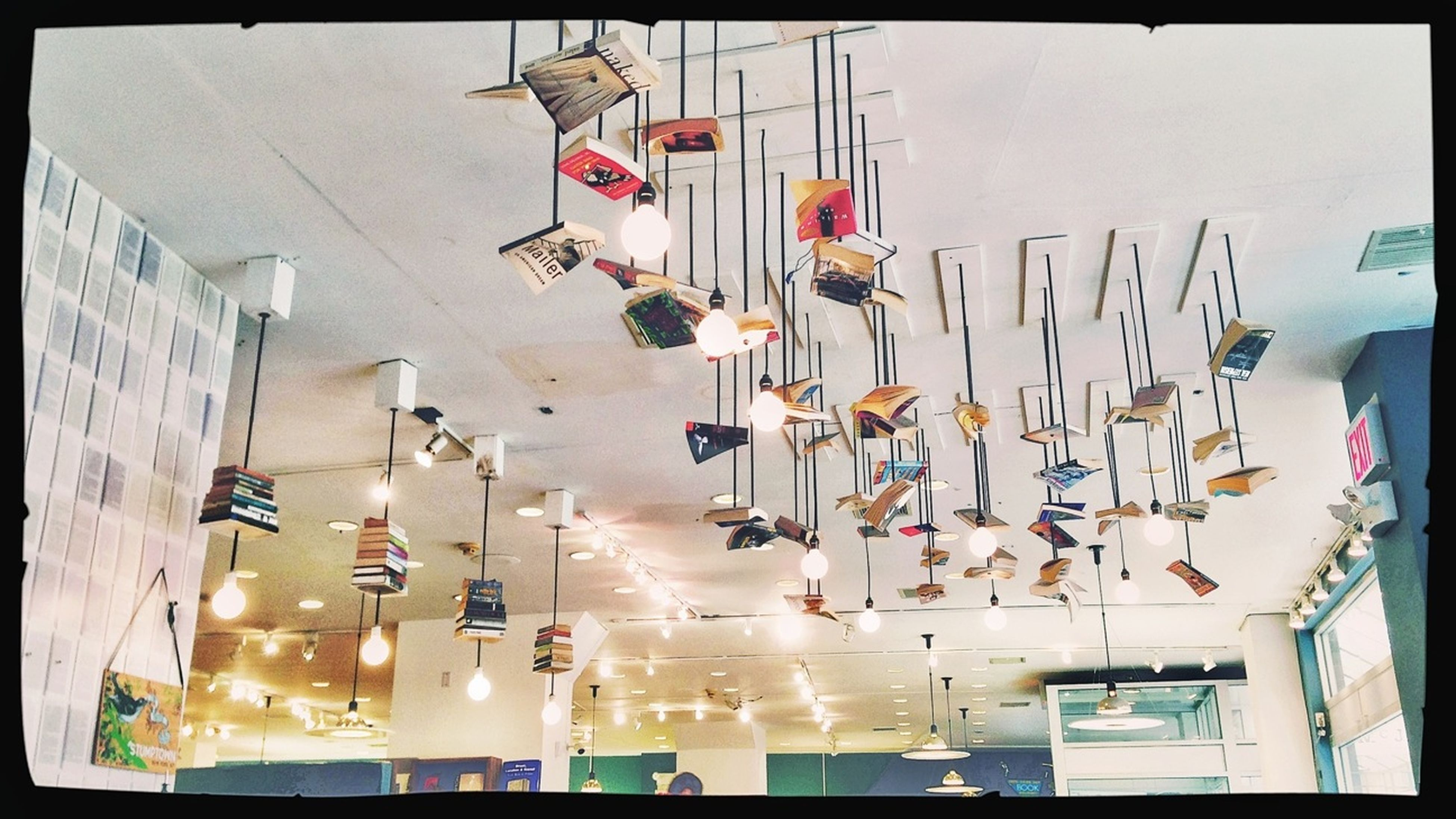 transfer print, indoors, auto post production filter, variation, arrangement, large group of objects, hanging, table, in a row, text, choice, abundance, western script, restaurant, built structure, day, store, order, communication, chair