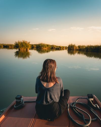 EyeEm Selects Ningxia China Water Lake Real People One Person Rear View Nature Sitting Reflection Beauty In Nature Leisure Activity Tranquility Tranquil Scene Tree Sky Sunset Outdoors Scenics Lifestyles Women Full Length EyeEmNewHere Perspectives On Nature